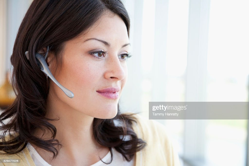 Businesswoman wearing headset : Stock Photo