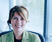 Businesswoman wearing headset, portrait