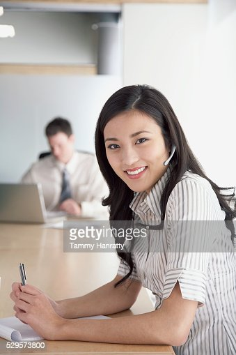 Businesswoman wearing telephone headset : Stock Photo