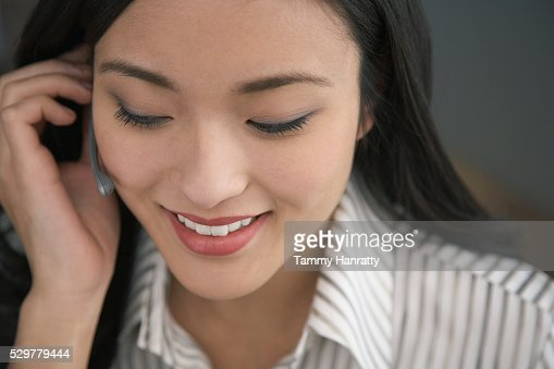Businesswoman wearing telephone headset : Foto stock