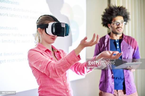 Businesswoman wearing virtual reality stimulator