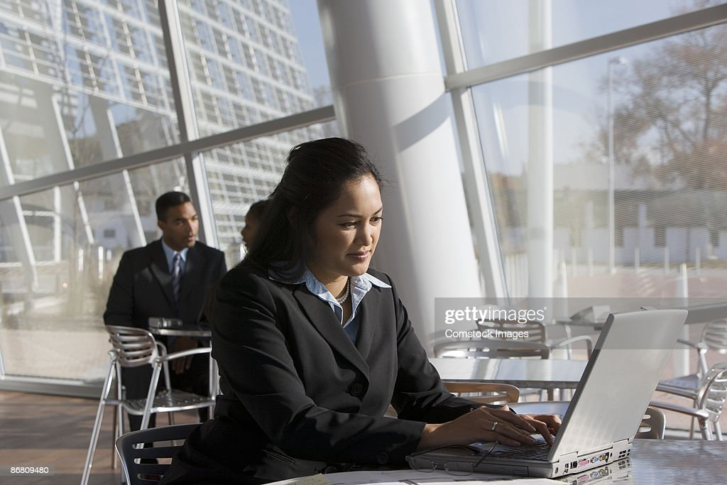 Businesswoman with a laptop : Stock Photo