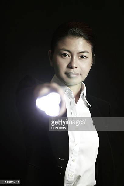 businesswoman with a light