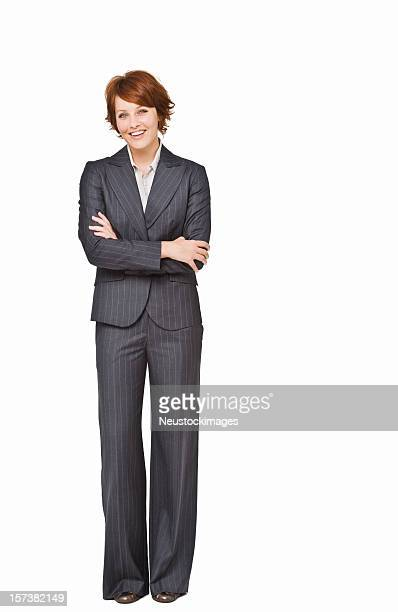 Businesswoman with arms crossed standing against isolated white background