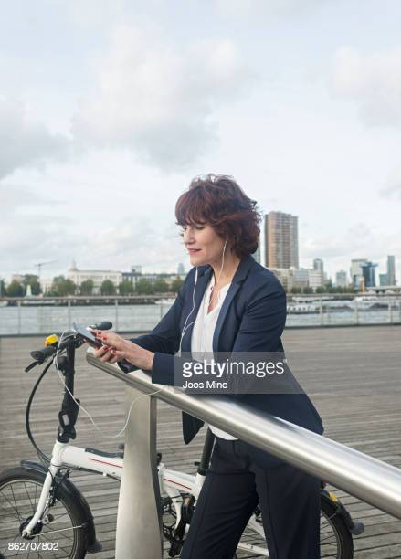 businesswoman with bike, using smart phone