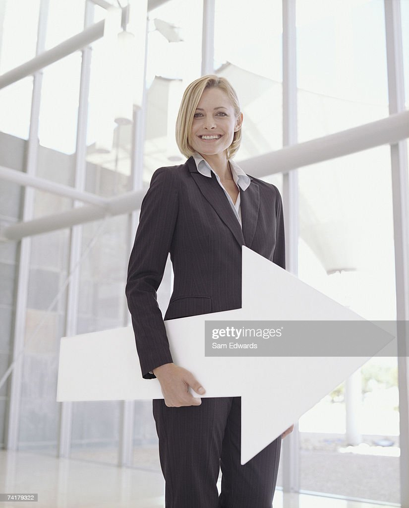 Businesswoman with blank sign arrow : Stock Photo