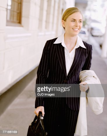 Businesswoman with briefcase and overcoat
