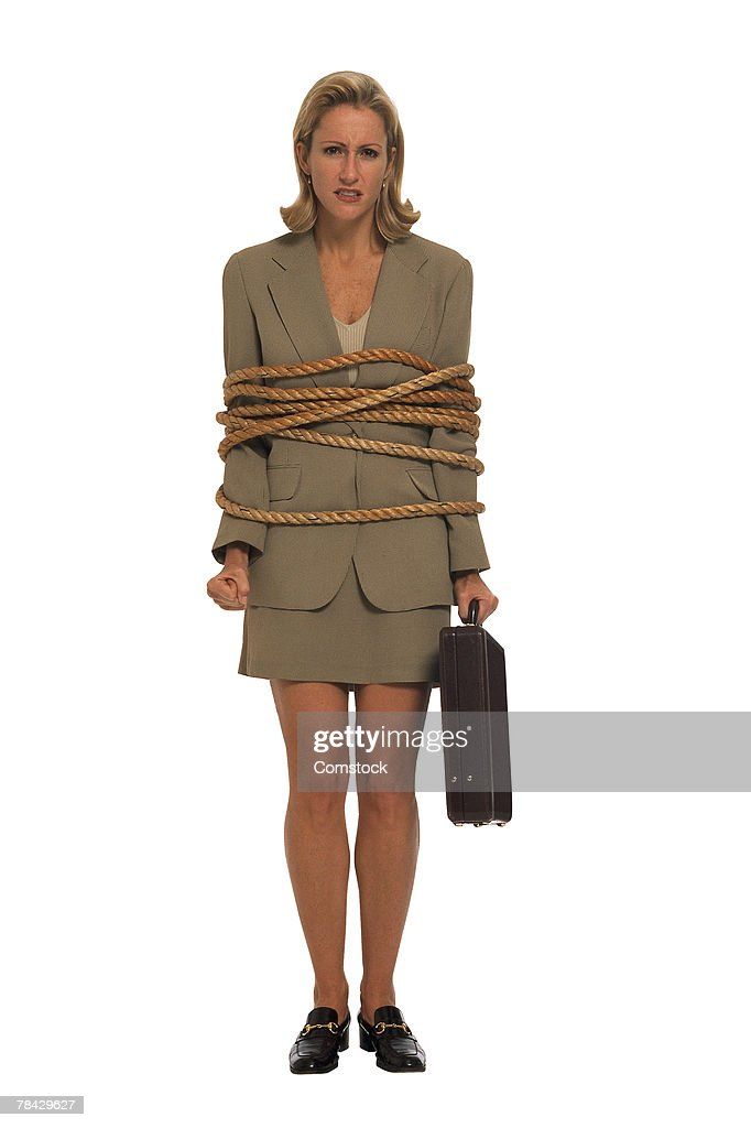 Businesswoman with briefcase bound in rope : Stock Photo