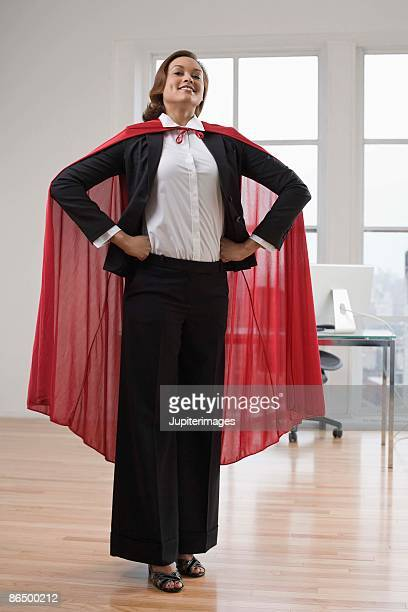 Businesswoman with cape in office