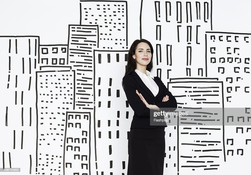Businesswoman with city scape drawing : Stock Photo