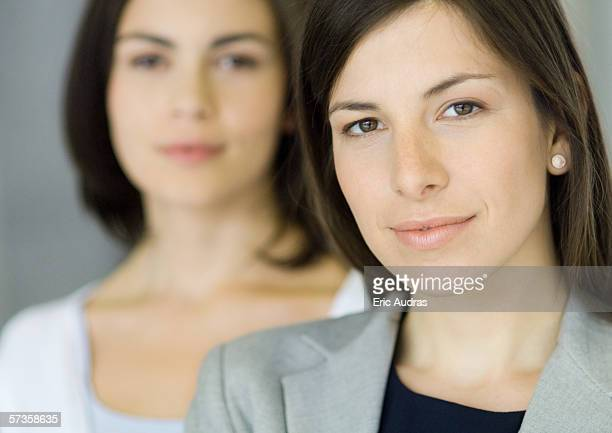Businesswoman with co-worker, portrait