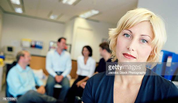 Businesswoman with coworkers