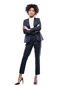 attractive african american businesswoman in suit with crossed arms, isolated on white