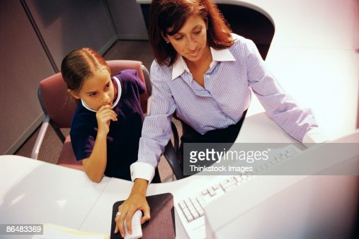 Businesswoman with daughter using computer : Stock Photo