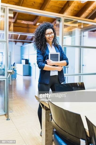 Businesswoman with digital tablet ready conference table
