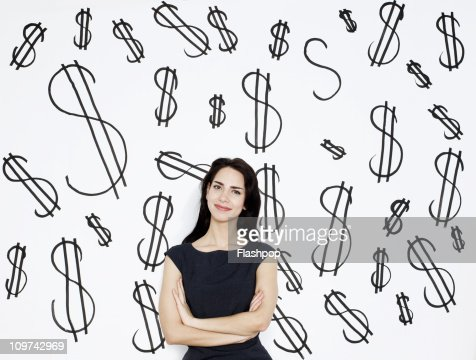 Businesswoman with dollar signs in the background : Stock Photo