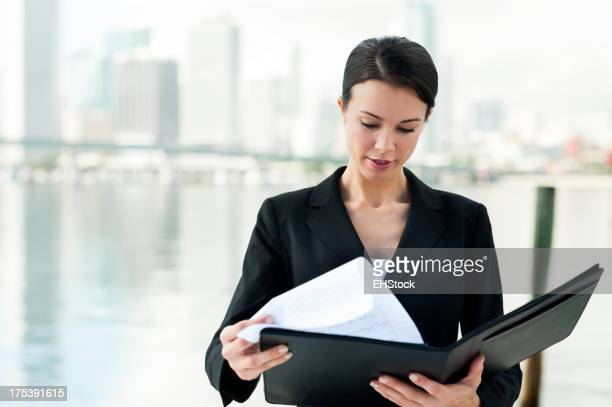 Businesswoman with Folio by Bay