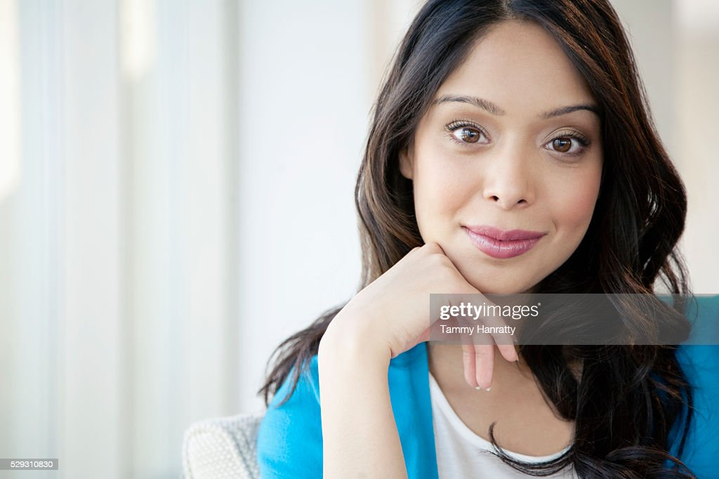 Businesswoman with head in hands : Stock Photo