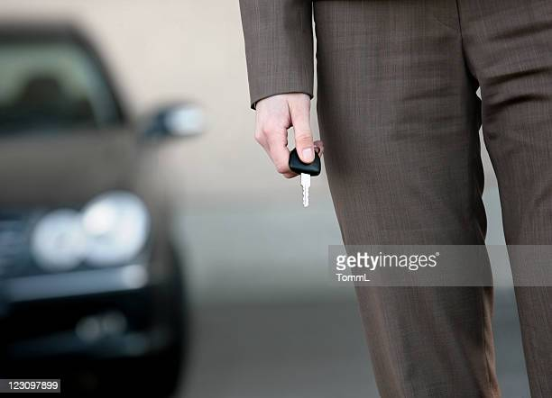 businesswoman with key and car