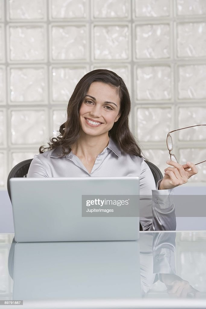 Businesswoman with laptop computer : Stock Photo