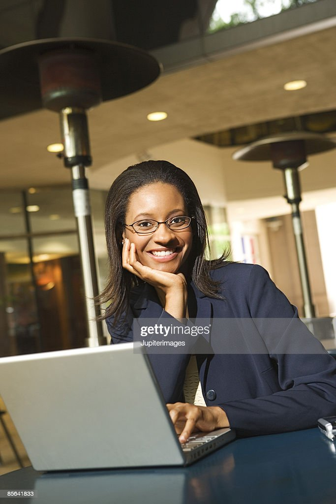 Businesswoman with laptop : Stock Photo