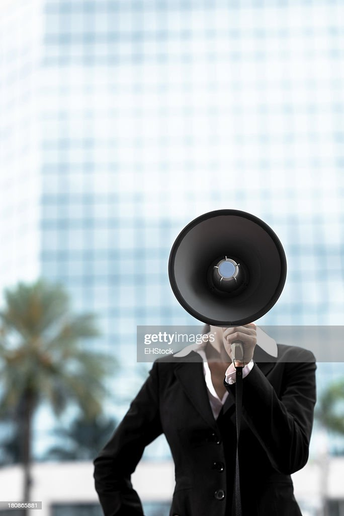 Businesswoman with Megaphone Bullhorn
