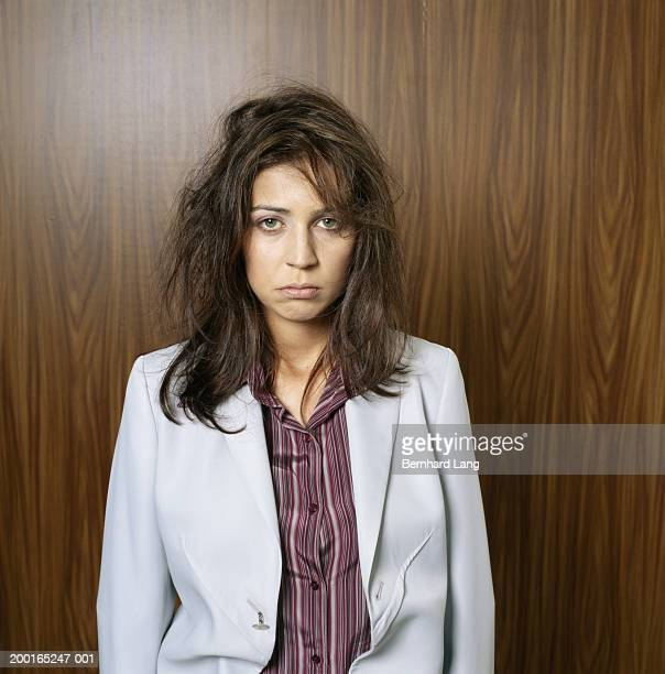 Businesswoman with messy hair, portrait