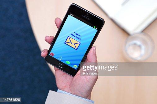 Businesswoman with new message on her phone : Bildbanksbilder