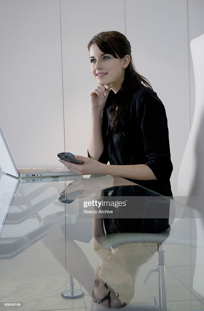 Businesswoman with pda and laptop computer : Stock Photo