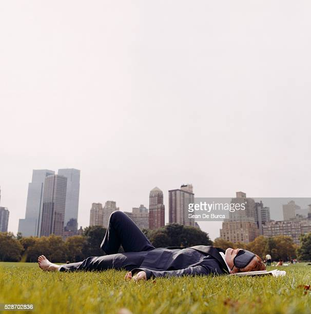 Businesswoman with Sleep Mask Relaxing in Park