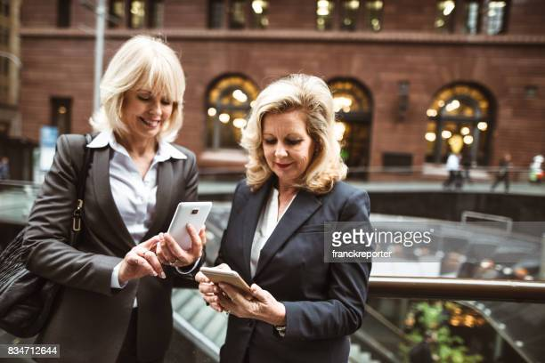 businesswoman with the smartphone in the downtown