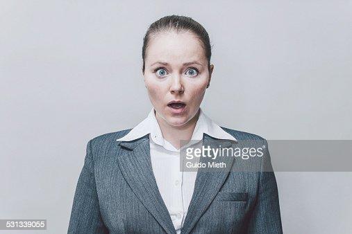 Businesswoman wondering.
