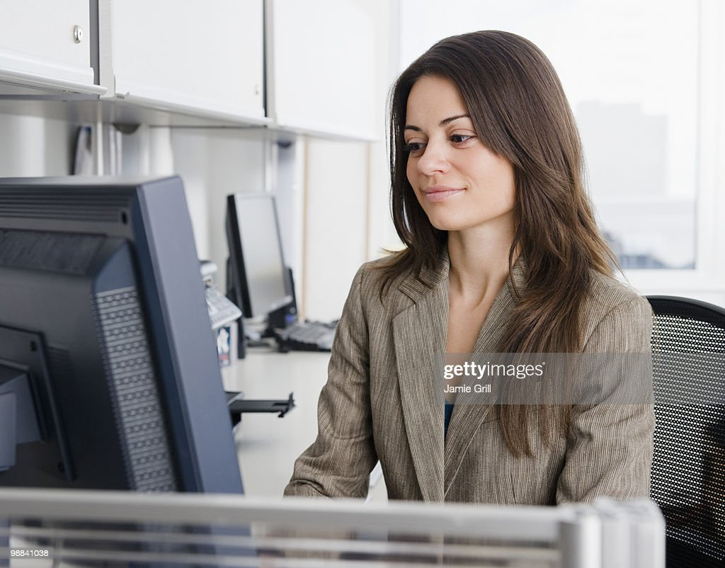 Businesswoman working at computer in office : Stock Photo