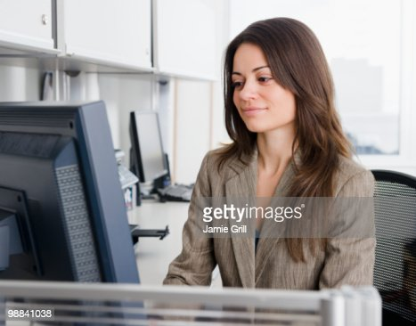 Businesswoman working at computer in office : ストックフォト