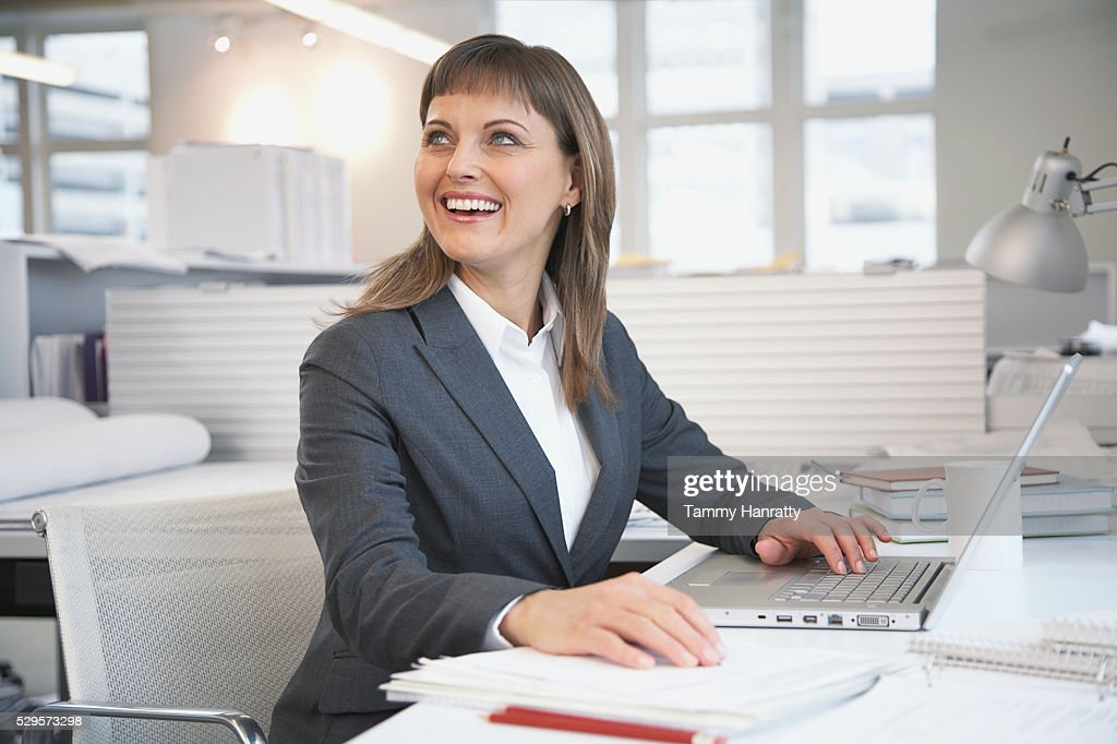 Businesswoman working at desk : Stock Photo