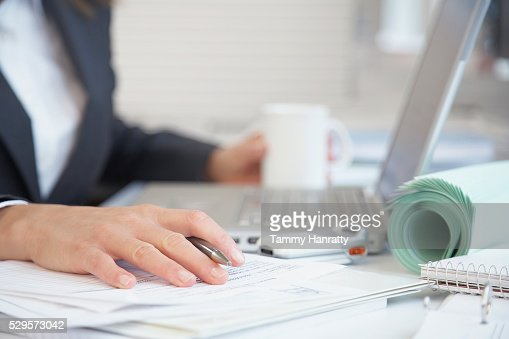 Businesswoman working at her desk : Stock Photo