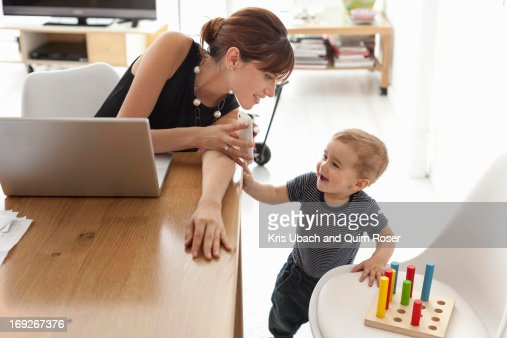 Businesswoman working at home : Stock Photo