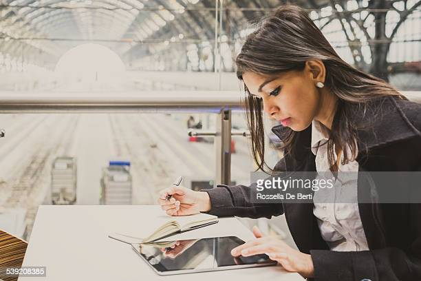 Businesswoman Working At Milan Central Train Station