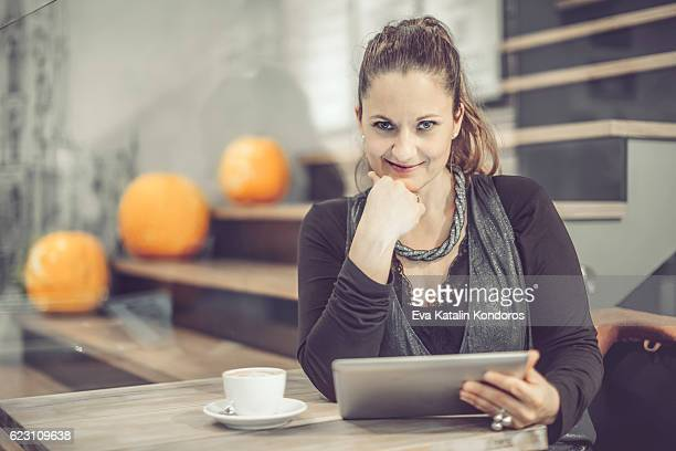 Businesswoman working in a cafe