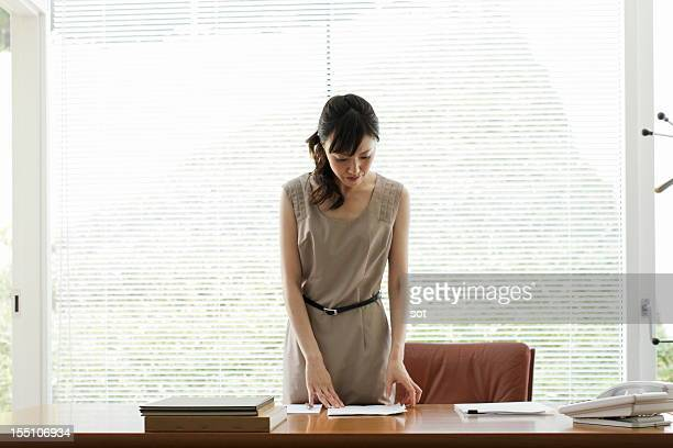 Businesswoman working in front of desk in office