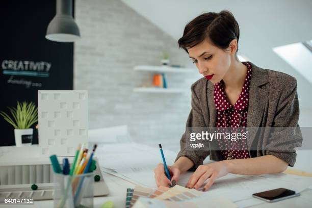 Businesswoman Working In Her Office.