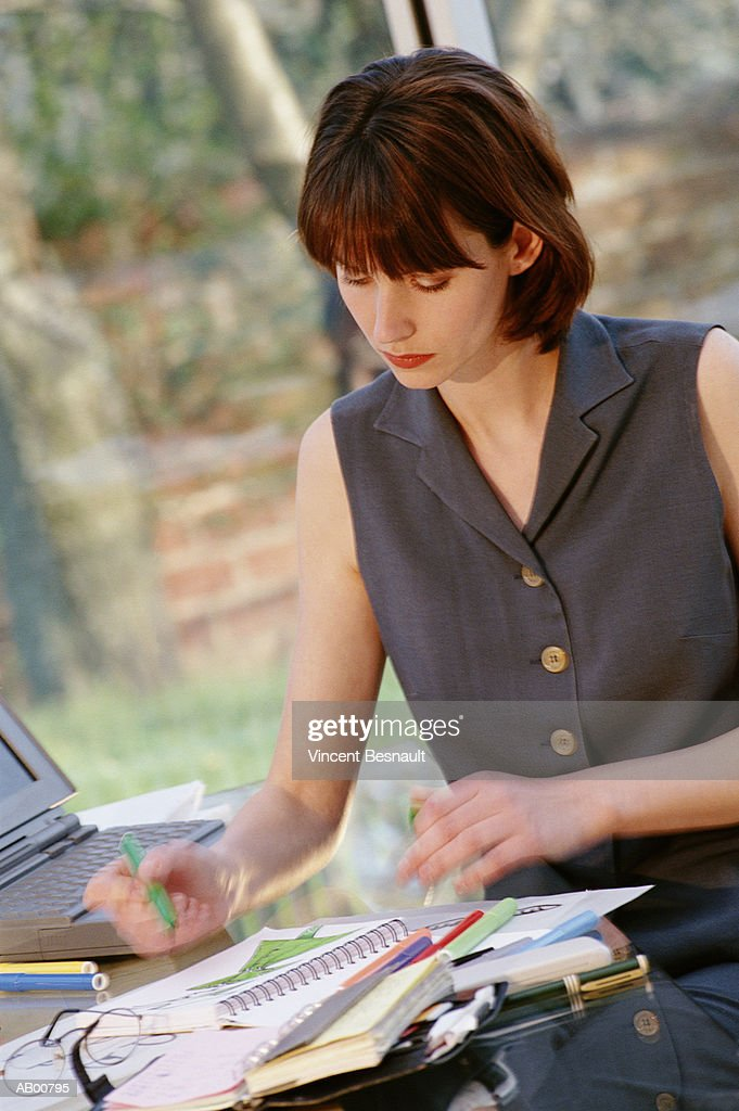Businesswoman working in home office : Stock Photo