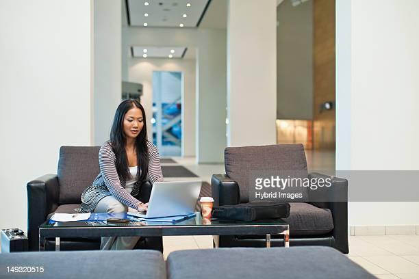 Businesswoman working in lobby