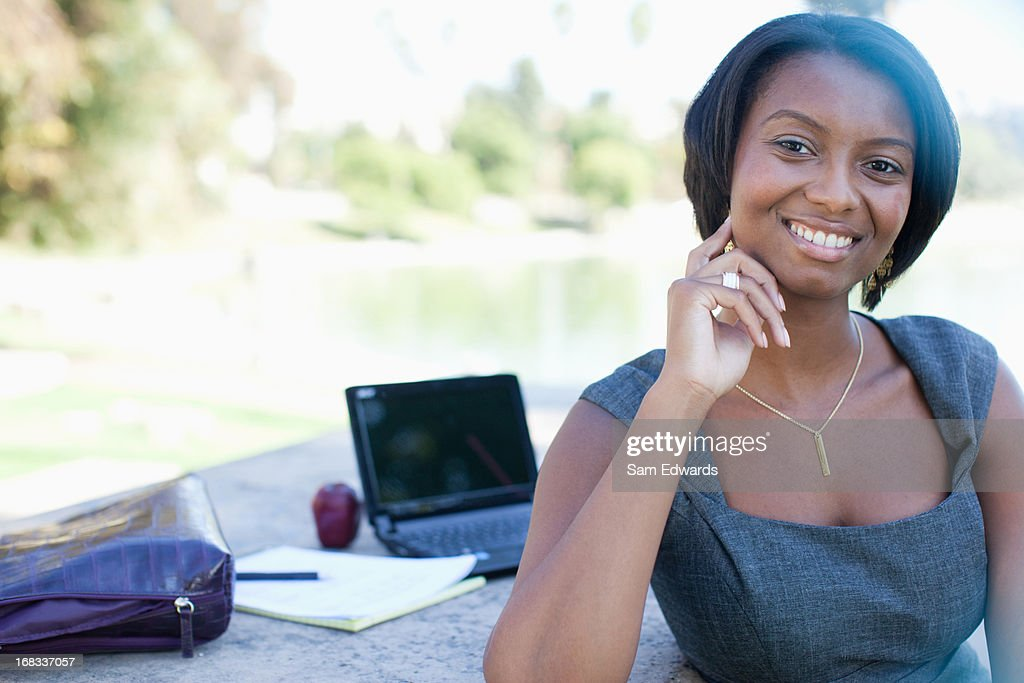 Businesswoman working in park : Stock Photo