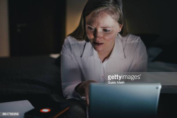 Businesswoman working late in evening.
