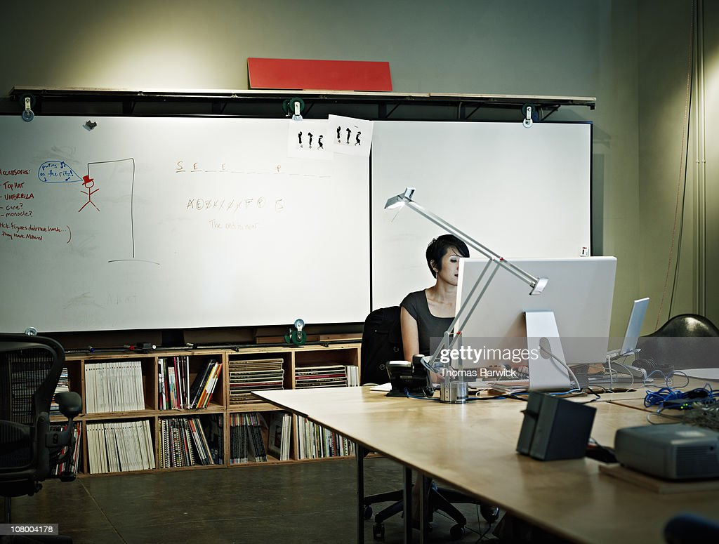 Businesswoman working on computer at workstation : Stock Photo