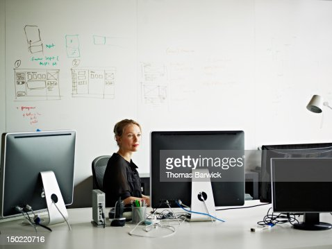 Businesswoman working on computer in office : Stock Photo
