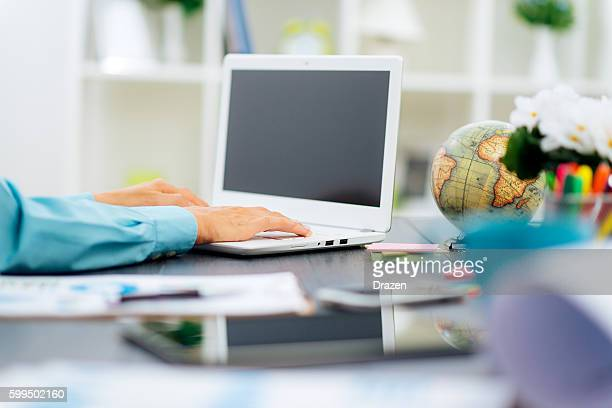 Businesswoman working on computer in office