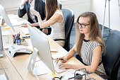 Businesswoman white collar worker concentrating on working with desktop computer in the office