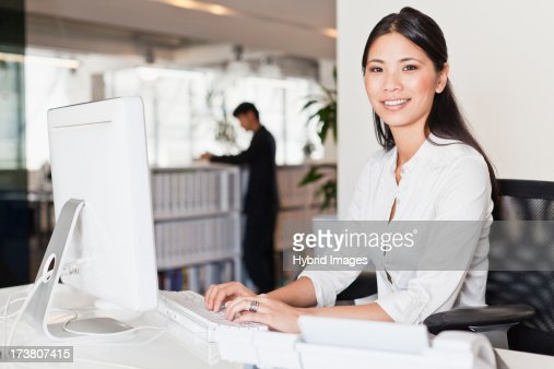 Businesswoman working on computer : Stock Photo